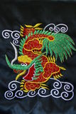 Filetto cinese del ricamo del drago Fotografie Stock Libere da Diritti