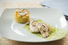 Filetto di merluzzo con la polenta Immagini Stock