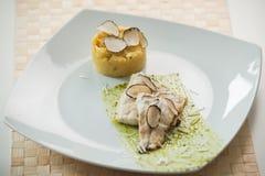 Filetto di merluzzo con la polenta Fotografia Stock