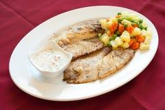 Filetto di pesce cotto, alimento libanese. Immagini Stock