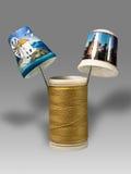 Filetto e cilindri porta caratteri. Fotografia Stock