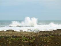 Filey brig waves crashing onto the rocks. Royalty Free Stock Images