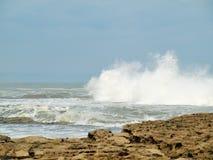 Filey brig waves crashing onto the rocks. Stock Image