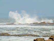 Filey brig waves crashing onto the rocks. stock photo