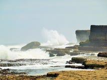 Filey brig waves crashing over the rocks Royalty Free Stock Image