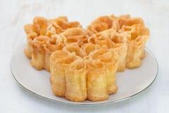 Filhos portugueses típicos da sobremesa na placa branca Imagem de Stock Royalty Free