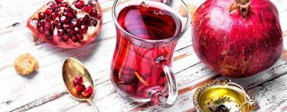 Filiżanka granatowiec herbata zdjęcie royalty free