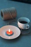 Filiżanka kawy i świeczka Zdjęcie Stock