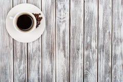 Filiżanka kawy i kawowe fasole obrazy royalty free