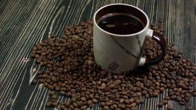 Filiżanka kawy i kawowe fasole zbiory