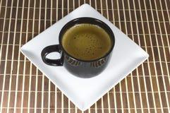 Filiżanka kawy na białym talerzu Zdjęcie Stock