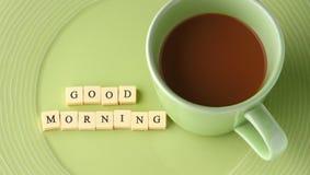 Filiżanka kawy z słowo dniem dobrym Zdjęcie Royalty Free
