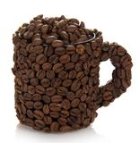 Filiżanka robić fasole, wypełniający z kawowymi adra Fotografia Stock