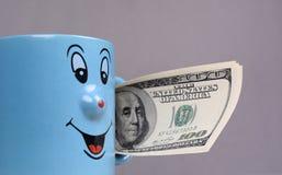 Filiżanka z dolara pieniądze w ręce Fotografia Royalty Free