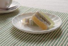 Filiżanka z herbatą i cukierkami Fotografia Stock
