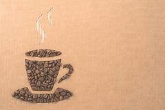 Filiżanka z kawowymi fasolami fotografia stock