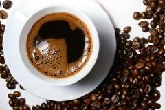Filiżanek i kawy fasole Zdjęcia Stock