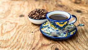 Filiżanka kawy i basen fasole Fotografia Stock