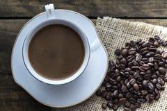 Filiżanka kawy i kawowe fasole Zdjęcie Stock