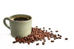 Filiżanka kawy i kawowe fasole Obrazy Stock