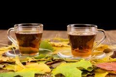 Filiżanki herbata na drewnianym stole Zdjęcie Stock