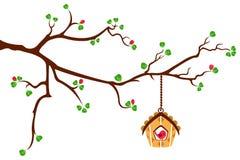 Filiale di albero con la casa dell'uccello di stile della capanna royalty illustrazione gratis