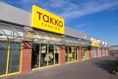 Filialen från TAKKO-mode shoppar Arkivbilder