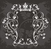 Filigree border with floral. A filigree border with floral elements and a crown Stock Photo