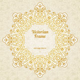 Filigree  frame in Victorian style. Filigree  frame in Victorian style in shape of a circle. Ornate element for design, place for text. Ornamental golden Royalty Free Stock Photo