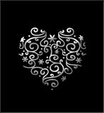 Filigree Heart. Silver filigree floral heart isolated on black Stock Images