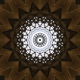 Filigree pattern of windows and ceiling. Digital art design. Abstract filigree texture, made of ceiling and windows of a church and brick walls, seen through vector illustration