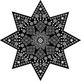 Filigree star white on black. White stars and christmas symbols on a bigger black star Royalty Free Stock Images