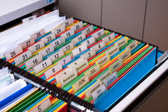 Filing Cabinet. Documents folders sorted for archive with colors and numbers Royalty Free Stock Images