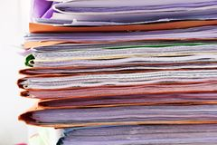 Filing cabinet #5. Heap of coloured files stock photo