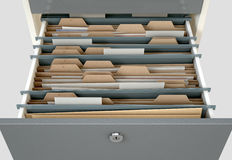Filing Cabinet Drawer Open Generic. A 3D render closeup view of an open filing cabinet drawer revealing generic documents inside Royalty Free Stock Photography