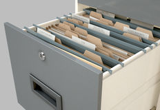 Filing Cabinet Drawer Open Tax. A 3D render closeup view of an open filing cabinet drawer revealling income tax related documents inside Royalty Free Stock Photos