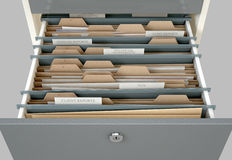 Filing Cabinet Drawer Open Tax. A 3D render closeup view of an open filing cabinet drawer revealling income tax related documents inside Stock Image