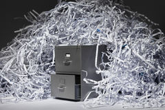 Filing Cabinet and Shredded Paper Stock Photo