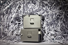 Filing Cabinet and Shredded Paper Royalty Free Stock Images