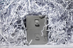 Filing Cabinet and Shredded Paper Stock Photos