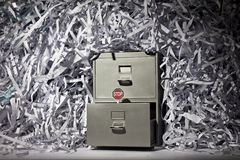 Filing Cabinet and Shredded Paper Royalty Free Stock Photos
