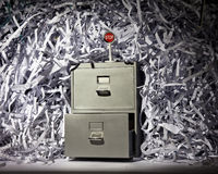 Filing Cabinet and Shredded Paper Royalty Free Stock Image