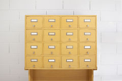 Filing cabinet wood- front view Stock Photos
