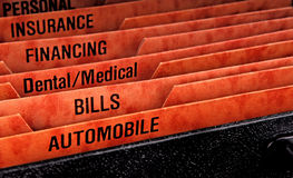 Filing folders for bills. Filing folders for recording expenses featuring automobile slot Stock Photo