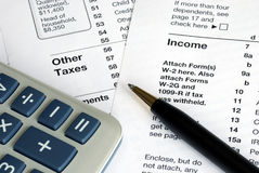 Filing the income tax return. By hand stock image