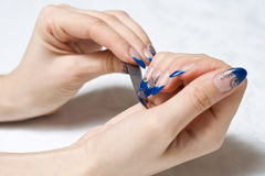 Filing nails Royalty Free Stock Images
