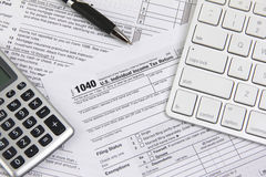 Filing online taxes before deadline. Filing taxes online using a computer Stock Photography