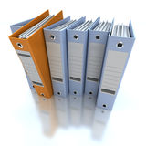 Filing and organizing information blue. 3D rendering of a line of office ring binders with one sticking out Stock Images