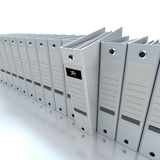 Filing and organizing information. 3D rendering of a line of office ring binders with one sticking out Stock Photos