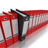Filing and organizing information. 3D rendering of a line of office ring binders with one sticking out Stock Photo